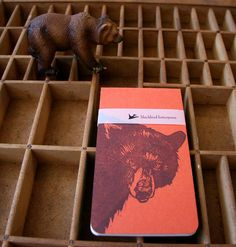 Black Bear notebook is one of 4 in a series of small notebooks. We work with a local printer down the street to bind the 30 paged inside notepad. Then we letterpress print the cover, wrap around and attach. It fits perfect in your pocket. Orange Paper, Small Notebook, Film Books, Letterpress Printing, Black Bear, Paper Goods, Book Design, Ink, Illustration