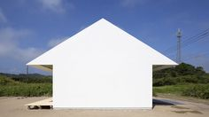 "Tokyo studio International Royal Architecture designed this seaside house with the ""form of a pure white arrow"".The exterior of ISM house is completely wrapped in waterproof fiberglass-reinforced polymer."