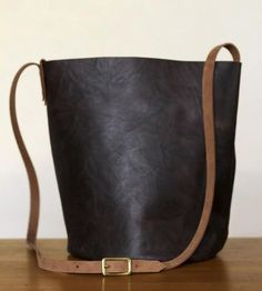 Brown Leather Bucket Bag | When a regular ol' tote just doesn't cut it, this bucket of a ... | Tote Handbags