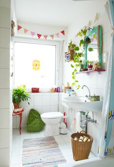 cute bathroom, white with touches of color.