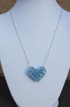 This is a beautifully designed Swarovski crystal necklace made in aquamarine and sterling silver. $30