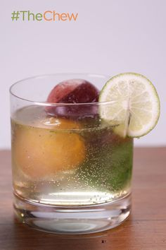 TECHNICOLOR TONIC Gin & Tonic 2 ounces gin 2 ounces tonic water 1 squeeze lime juice flavored ice cubes to serve
