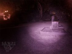 Ghost hunters from the Sydney South West Paranormal Investigators (SSWPI) of Sydney, Australia were investigating the haunted St. Bartholomew's Cemetery when they took this picture that seems to show a ghost walking near one of the headstones.