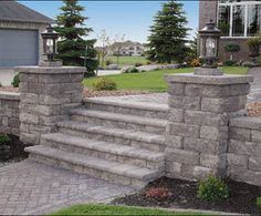 Draw visitors to your home and make them feel welcome with beautiful steps and walkways like this natural stone design. Lights on the retaining wall columns will show it off at night and make it safer. We offer landscape design and installation in the Minneapolis MN area. http://www.aldmn.com