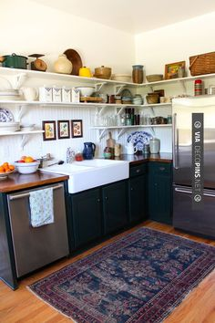 Cozy kitchen dream kitchen wood floor dark cabinets navy black white wood wall open shelf shelving farmhouse sink farm house stainless steel rug
