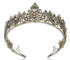 A GEORGE III DIAMOND TIARA  Designed as a series of foliate scrolls, the central panel with stylized plume surmount set throughout with rose-cut diamonds to the closed-back setting, mounted in silver and gold, circa 1790, frame 45.5 cm  THE PROPERTY OF A NOBLEMAN Christie's Geneva Nov. 2009