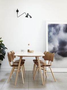 modern dining room with black wall sconce