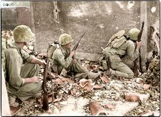 US Marines of the 29th Regiment, 6th Division securing Naha, the capital city of Okinawa. 25th May 1945.