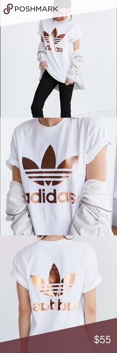 Rose Gold foil logo Adidas white tee Sporty-luxe rose gold logo tee exclusively for UO from adidas Originals. In a relaxed fit featuring front + back metallic tres foil graphics. Finished with a ribbed knit crew-neck and short sleeves. Adidas Tops Tees - Short Sleeve