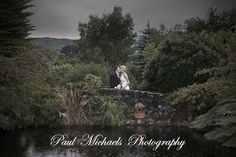 Tom and Nikki in the rain at Kaitoke.  Wedding photography in Wellington, New zealand. Pictures by PaulMichaels photographers http://www.paulmichaels.co.nz