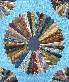 NECKTIE QUILT - by Bonnie Harmon - quilted by DLQ, via Flickr.  Now I know what to do with that huge box of neck ties Mom was going to use for a quilt.   This is neat!