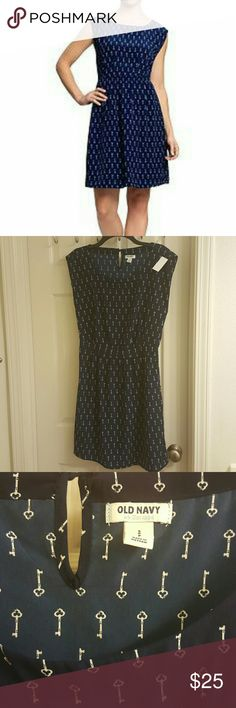 NEW OLD NAVY SWING DRESS This a cute Old Navy key print swing dress.  It has keys printed all over  It is lined   Sleeveless with an elastic fitted waist   Scoop neckline and a button key hole in the back  Color Navy Blue and white Old Navy Dresses