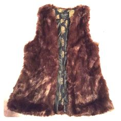 Faux Fur Vest Brown faux fur vest with faux leather lining and super cute interior! Perfect for fall/winter! Never worn. Size XS but will fit up to a size medium. Make an offer! Jackets & Coats