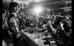 Oct 23, 1974: Former Beatles member, George Harrison, faces photographers during a press conference at the Beverly Wilshire Hotel to promote his U.S. and Canadian band tour.