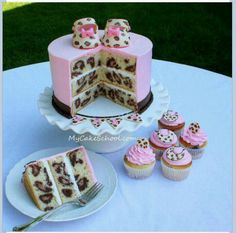 Cute pink baby shower cake with cheetah design