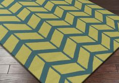 Surya Fallon FAL-1091 Area Rug From delicate lattice patterns to boldly colored chevron patterns the Fallon Collection makes a statement in flat weave; from creator Jill Rosenwald known for her beautifully colored, hand-made ceramics.