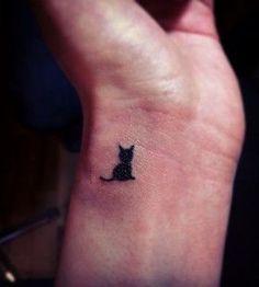 Small wrist cat tattoo                                                                                                                                                      More