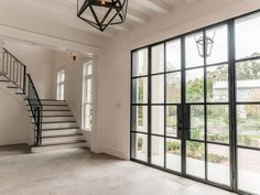 2410 Avalon Place Houston, TX 77019: Photo The generously sized Grand Foyer provides ample space for welcoming friends & family. Just out of sight, on the left, an alcove houses a Powder Room & Elevator Shaft. Note the gorgeous double Durango Entry doors and Beamed Ceiling. (Foyer 12x18).