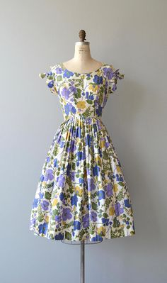 Vintage 1950s cotton dress with periwinkle, mustard, green and lavender floral print, scoop neckline, open tie shoulder sleeves, fitted waist and metal back zipper. --- M E A S U R E M E N T S --- fits like: medium bust: 36-37.5 waist: 28 hip: free length: 43 brand/maker: n/a condition: excellent to ensure a good fit, please read the sizing guide: http://www.etsy.com/shop/DearGolden/policy ✩ layaway is available for this item ✩ more vintage dresses ✩ htt...