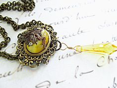 $55  Fairy fantasy yellow necklace with Swarovski Citrine crystal and a yellow cat's eye. Antiqued Brass filigree components for a vintage style look. Great yellow statement necklace!