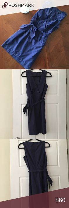 Banana republic navy blue belted sleeveless dress Beautiful navy blue banana republic sleeveless size 8 dress. Criss cross v neck neckline. Dress has a tie belt and pockets. It is lined. I added one stitch to keep the neckline a little  more modest. If you wish that'd be easy to take out. Zips in the back. Smoke free dog friendly home. Banana Republic Dresses
