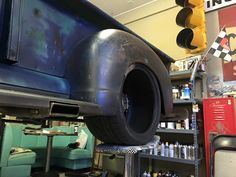 notched running boards around a square exhaust tip in a Chev Advanced Design pickup truck.
