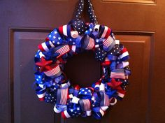 Good for the 4th of July and year round.  Super summer wreath!  Patriotic Ribbon Wreath for Front Door 4th by CraftCreationsbyJen, $40.00