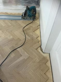 Client: Private Residence In West London Brief: To supply & install herringbone wood flooring