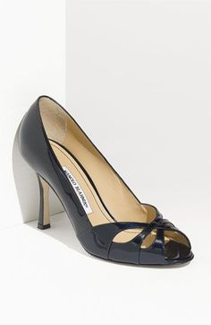 Manolo Blahnik...just tried these on at Nordy's with @Jill O'Brien. So sad they didn't fit :(