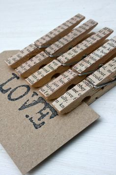 """Vintage style pegs decorated with pages from old books. - again I say, """"no!"""" The older the book the more the reason to not destroy it. And for clothes pins!!! So wrong. Book killing #8."""