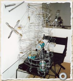 An upcycled wire coat hanger marble run