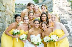 Summer Bride with her bridesmaids in yellow strapless bridesmaid dresses!