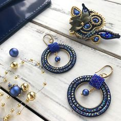 Unusual soutache kit in the color Sapphire. Amazing flower soutache brooch with Swarovski crystals and Swarovski dark blue pearls from the last summer collection. And lightweight soutache hoop earrings in the same color.