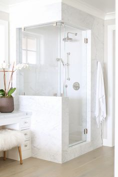 Bathroom Marble Shower Surround. Marble shower frame is Statuarietto marble. #marble #showerframe #Statuarietto Winkle Custom Homes. Melissa Morgan Design. Ryan Garvin Photography