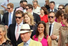 Prnce Harry (left) Nico Jackson (second left), Princess Beatrice (centre in red) and Pippa Middleton (centre front) joined the throngs to enter the castle to celebrate their friends  Charlie Gilkes and Anneke von Trotha Taylor getting hitched  Sept. 20, 2014
