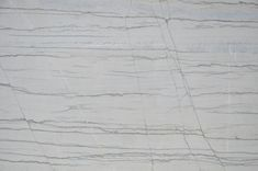 White Macaubus quartzite, provided by Elements #quartzite #kitchen #bathroom #countertop #DallasDesign #Elements http://fabstoneweb.stoneprofits.com/default-L-Elemfents