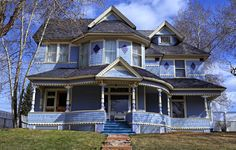Large old double story house with wrap around porch and veranda