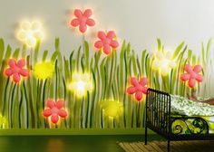 Kid's Room Decor Idea: Paint walls with greenery then add cheerful Smila Blomma flower wall lights from Ikea.