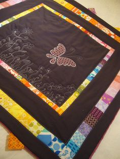 Custom Order Butterfly Quilt | Flickr. Ok, nothing quite so ambitious, but I like the idea.