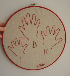 Embroidered family hand prints