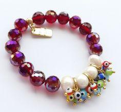 Pulsera piedras rojas con perlas y ojo turco