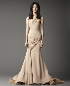 One shoulder soft mermaid gown with asymmetrical gathering and ruffled tulle train