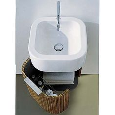 Tiny vanity sink that hangs on the wall - for the someday mini-bath on the main floor.