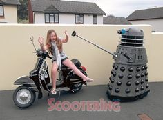 DVLA Dalek exterminating Katie-Ann on dad Will Carter's Vespa. Both were built by Will (the Dalek and the Vespa that is!). -