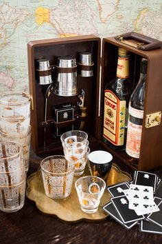 for the coolest man in the world - a travel bar set complete with playing cards, shot glasses, bottle opener, and cups.