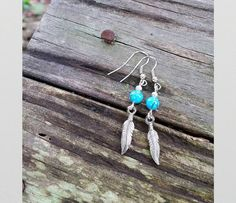 Hey, I found this really awesome Etsy listing at https://www.etsy.com/listing/233511813/turquoise-and-feather-earrings