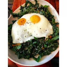 kale salad with jellyfish-shaped eggs at Northern Spy Co.