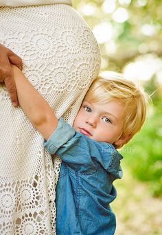 Cute maternity photo with child hugging belly...OMG!
