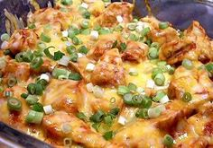 In the crock pot - Chicken breasts, enchilada sauce, taco seasoning, shredded cheese, and green onions.  add some cilantro to the top, then served up in soft tortillas with rice.  YUMMY and EASY.