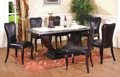 Update your dining area with this marvelous 7 Pcs Rectangular Dining Set. It is in a rich espresso color with an ivory and granite color marble.  The chairs are upholstered in faux leather with a curved back shape to match with the base of the table.
